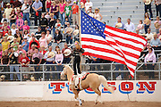 Cowgirls perform at the 84th Annual Tucson Rodeo, also know as Fiesta De Los Vaqueros, in Tucson, Arizona, USA.