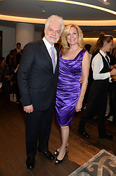 DR HAROLD LANCER and his wife DANNI LANCER at a reception to launch the range of Dr Lancer beauty products held at The Penthouse, Harrods, Knightsbridge, London on 16th September 2013.
