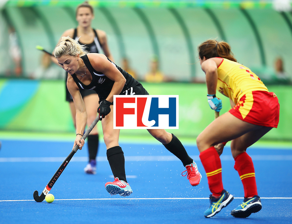 RIO DE JANEIRO, BRAZIL - AUGUST 10:  Gemma Flynn of New Zealand is faced by Lola Riera of Spain during the Women's Pool A Match between Spain and New Zealand on Day 5 of the Rio 2016 Olympic Games at the Olympic Hockey Centre on August 10, 2016 in Rio de Janeiro, Brazil.  (Photo by Mark Kolbe/Getty Images)