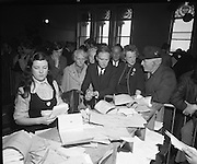 Mr Liam Cosgrave,Leader of Fine Gael,at Vote Count. (E48)1973..01.03.1971..03.01.1973..1st March 1973..As the ballot boxes were opened in Dun Laoghaire Town Hall, Mr Cosgrave and his supporters watched as the voting papers were piled high. The vote was as the result of an often hectic General Election campaign. Mr Cosgrave was hoping his party would garner enough votes to oust the sitting Fianna Fail Government which had held power for sixteen years...Image Of Mr Cosgrave as he anxiously watches the ballots being organised for counting.