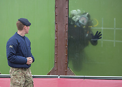 LNP Weekly Highlights 28/03/14  26/03/2014. Members of the Royal Engineers diving team display their dive tank as the British Army reveal it's new specialist, combat and command skills formation today. This new part of the Army will be made up of 36000 Regular and Reserve soldiers, which is a third of the army as a whole and supports the logistics of operations both in the UK and abroad.  The command will officially launch on the 1 Apr 14.  Alison Baskerville/LNP