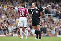 Photo: Paul Thomas.<br /> West Ham United v Arsenal. The Barclays Premiership. 24/09/2005.<br /> <br /> Arsenal keeper Lens Lehmann comes out of hie goal feet first and takes out West Ham striker Marlon Harewood, but the referee Mike Dean doesn't give the penalty, as Nigel Reo-Coker argues the point.