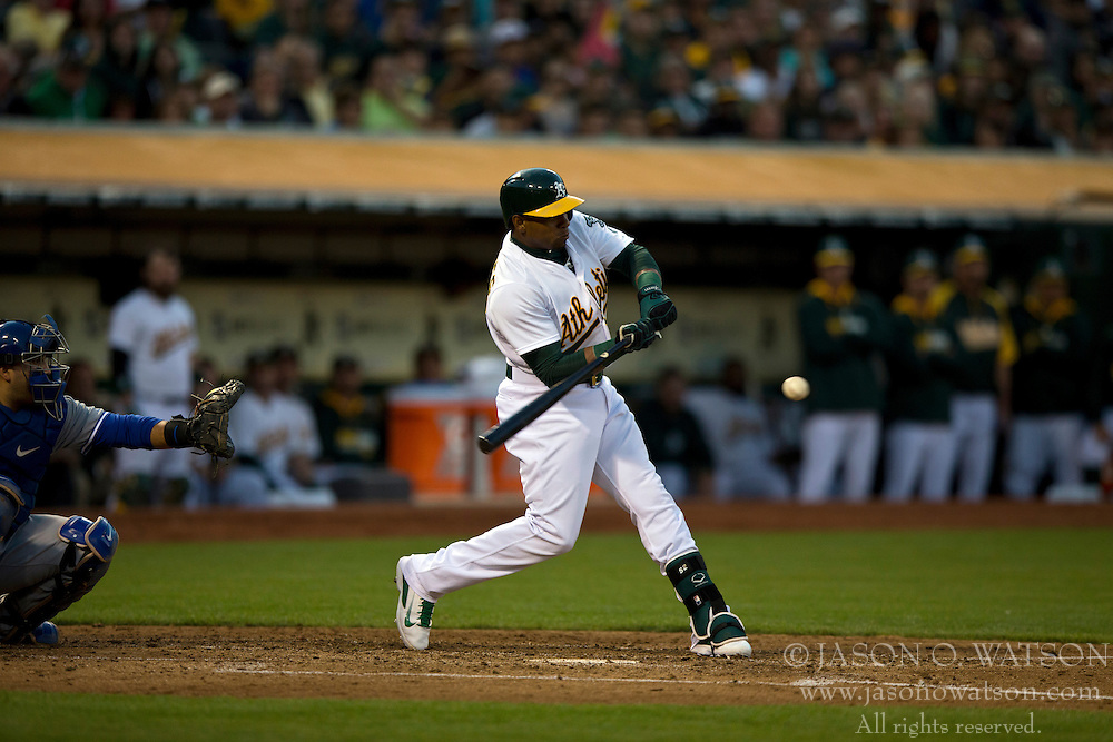 OAKLAND, CA - JULY 05:  Yoenis Cespedes #52 of the Oakland Athletics at bat against the Toronto Blue Jays during the fourth inning at O.co Coliseum on July 5, 2014 in Oakland, California. The Oakland Athletics defeated the Toronto Blue Jays 5-1.  (Photo by Jason O. Watson/Getty Images) *** Local Caption *** Yoenis Cespedes