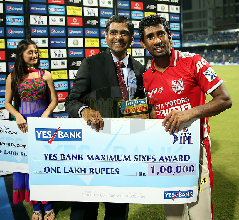 Wriddhiman Saha of the Kings X1 Punjab recives the maximum sixes award during the presentation of the  match 22 of the Pepsi Indian Premier League Season 2014 between the Mumbai Indians and the Kings XI Punjab held at the Wankhede Cricket Stadium, Mumbai, India on the 3rd May  2014<br /> <br /> Photo by Sandeep Shetty / IPL / SPORTZPICS<br /> <br /> <br /> <br /> Image use subject to terms and conditions which can be found here:  http://sportzpics.photoshelter.com/gallery/Pepsi-IPL-Image-terms-and-conditions/G00004VW1IVJ.gB0/C0000TScjhBM6ikg