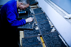 June 25, 2017 - Shaoyang, Shaoyang, China - Shaoyang, CHINA-June 25 2017: (EDITORIAL USE ONLY. CHINA OUT) Xiao Shihua, an inheritor of traditional skill of movable type woodblock printing, works at his studio in Shaoyang, central China's Hunan Province, June 25th, 2017. The movable type?woodblock printing is the system and?technology?of?printing?and?typography?that uses movable?components?to reproduce the elements of a document usually on the medium of?paper. (Credit Image: © SIPA Asia via ZUMA Wire)