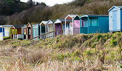 Wooden beach huts at Coldingham Bay in Scottish Borders, Scotland, United Kingdom