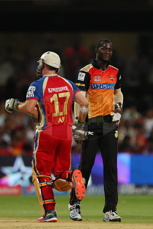Darren Sammy of the Sunrisers Hyderabad reacts after being hit all over the park by AB de Villiers of the Royal Challengers Bangalore during match 24 of the Pepsi Indian Premier League Season 2014 between the Royal Challengers Bangalore and the Sunrisers Hyderabad held at the M. Chinnaswamy Stadium, Bangalore, India on the 4th May  2014<br /> <br /> Photo by Ron Gaunt / IPL / SPORTZPICS<br /> <br /> <br /> <br /> Image use subject to terms and conditions which can be found here:  http://sportzpics.photoshelter.com/gallery/Pepsi-IPL-Image-terms-and-conditions/G00004VW1IVJ.gB0/C0000TScjhBM6ikg