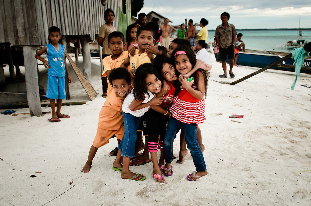 Philippines, Tawi Tawi. Group of little children on one of the Filipino tropical islands.