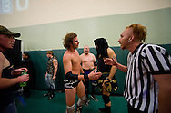 """Wrestlers, referees and Championship Wrestling Entertainment staff congratulate each other after a match during the Live Pro Wrestling event at the Port St. Lucie Civic Center on Friday, May 15, 2015. CWE is a local """"indie"""" wrestling company headquartered in Port St. Lucie. (XAVIER MASCAREÑAS/TREASURE COAST NEWSPAPERS)"""