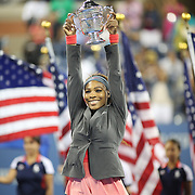Serena Williams, USA, with her trophy after winning the Women's Singles Final at the US Open, Flushing. New York, USA. 8th September 2013. Photo Tim Clayton