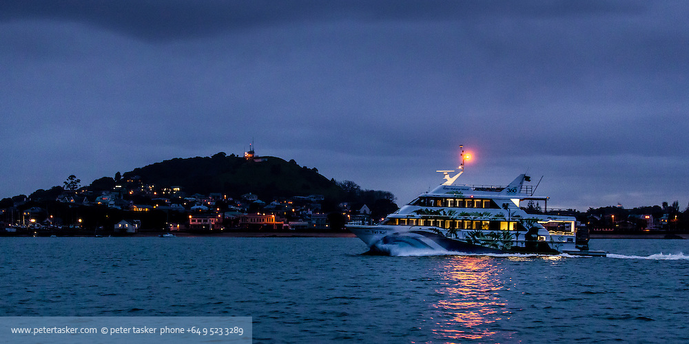 The 360 ferry Tiri Kat passing Devonport on her evening return to Auckland.