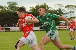 Ballintubber's Damien Coleman races past Charlestown's Martin Mulvaney during the club championship game in Clougher on saturday last.<br /> Pic Conor McKeown