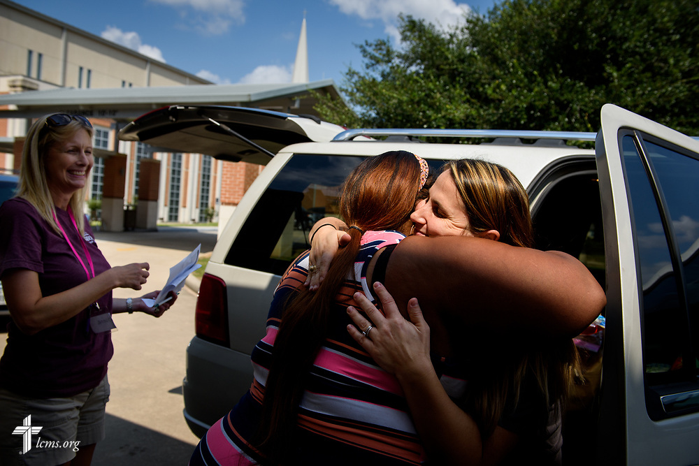 Kylie McCharon, a volunteer and church member at <br /> Trinity Klein Lutheran Church, Spring, Texas, hugs Hurricane Harvey victim Laquanda Martin after loading donated food and supplies into her car at the church on Saturday, Sept. 2, 2017. LCMS Communications/Erik M. Lunsford