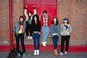 CSS whole band standing in front of a brick wall, CSS gig, February 2007