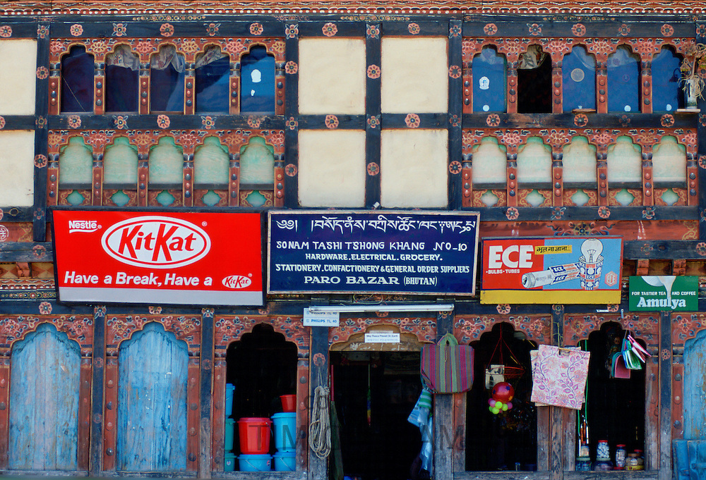 Advertisements above a shop in Paro, Bhutan that sells hardware, grocery, electrical, confectionery and stationery.