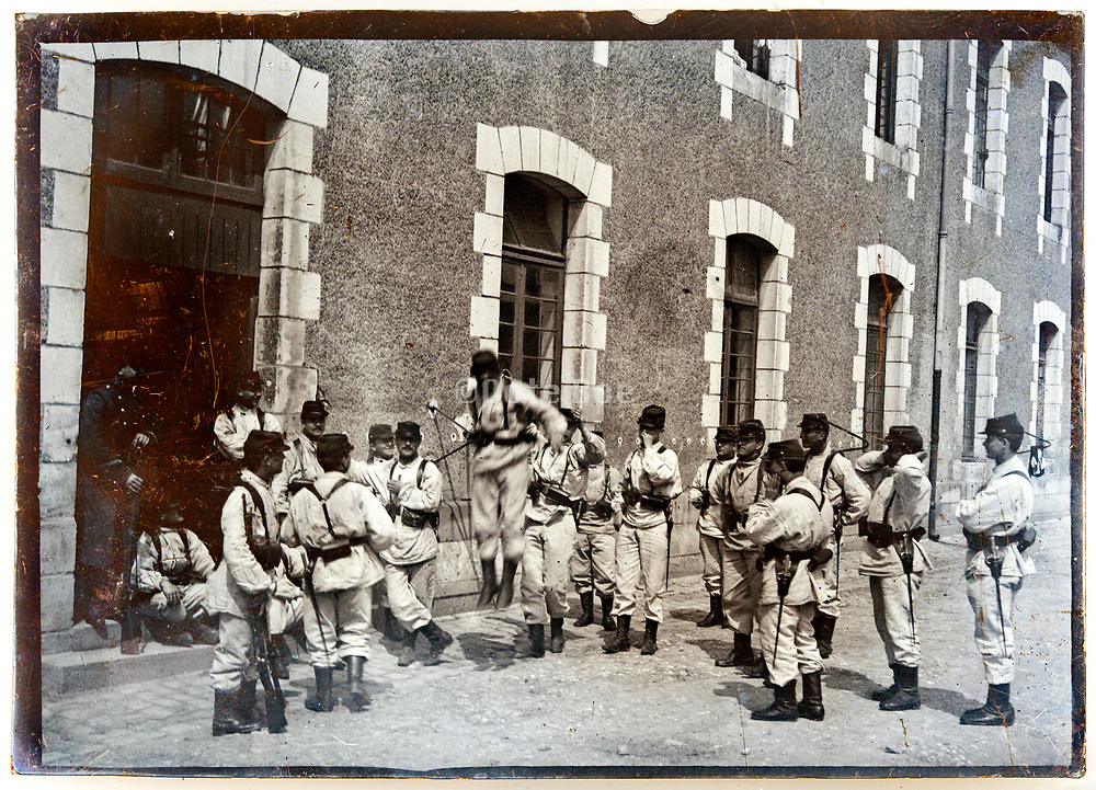ww1 period soldiers standing and relaxing in front of barrack building France
