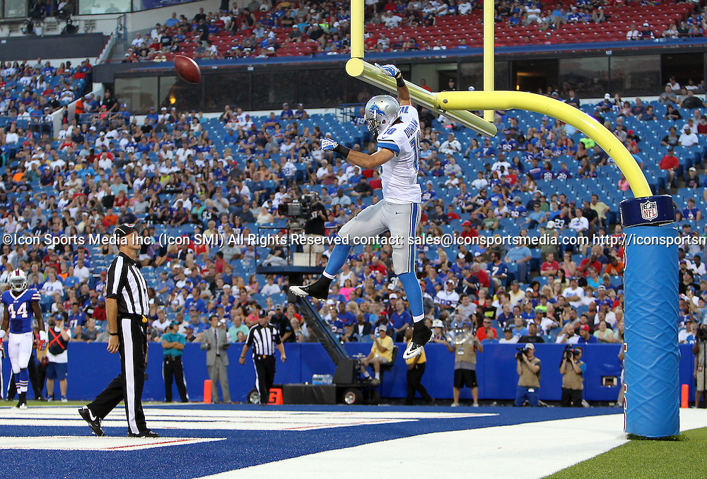 29 August 2013: Detroit Lions wide receiver Kris Durham (18) dunks the ball after catching a pass for a touchdown during a preseason NFL game between the Detroit Lions and Buffalo Bills at Ralph Wilson Stadium in Orchard Park, NY.