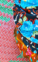 Close up of colorful clothing patterns worn by a woman shopping at the market on Nusa Penida, Bali, Indonesia