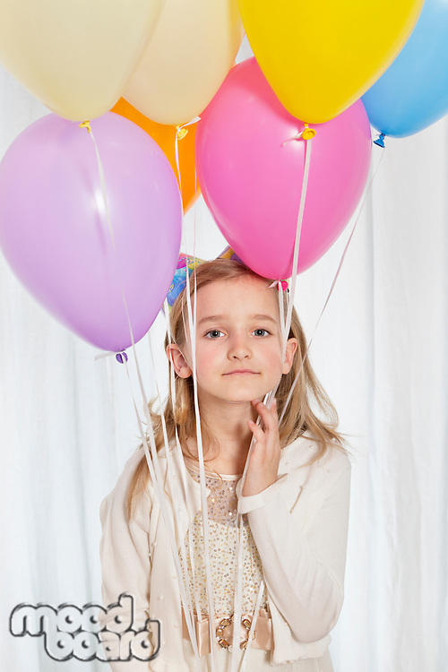 Portrait of a young girl with party balloons