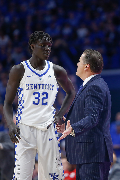Kentucky Wildcats forward Wenyen Gabriel listens as Kentucky Wildcats head coach John Calipari talks to him against the Kansas Jayhawks on Saturday January 28, 2017 at Rupp Arena in Lexington, Ky. Photo by Michael Reaves | Staff