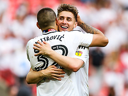 Free to use courtesy of Sky Bet. Tom Cairney hugs Aleksandar Mitrovic as Fulham celebrate winning the game 0-1 to win the Sky Bet Championship Play-Off Final and secure Promotion to the Premier League - Rogan/JMP - 26/05/2018 - FOOTBALL - Wembley Stadium - London, England - Aston Villa v Fulham - Sky Bet Championship Play-Off Final.