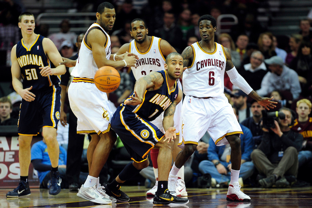 Feb. 2, 2011; Cleveland, OH, USA; Indiana Pacers shooting guard Dahntay Jones (1) makes a pass around Cleveland Cavaliers shooting guard Joey Graham (12) during the first quarter at Quicken Loans Arena. Mandatory Credit: Jason Miller-US PRESSWIRE