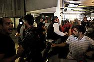 Roma 13 Giugno 2013<br /> I movimenti di lotta per la casa hanno occupato in mattinata la sede dell' Acea per protestare contro i distacchi dell' acqua nelle case occupate. Un addetto alla sicurezza tenta di bloccare gli occupanti che salgono negli uffici