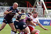 Hull Kingston Rovers back row Danny Tickle (34) is halted by three Leeds Rhinos lalyers including Leeds Rhinos second row forward Carl Ablett (12) and Leeds Rhinos loose forward Stevie Ward (13)  during the Betfred Super League match between Hull Kingston Rovers and Leeds Rhinos at the Lightstream Stadium, Hull, United Kingdom on 29 April 2018. Picture by Mick Atkins.