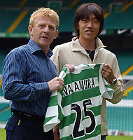 Shunsuke Nakamura parades at Celtic  park today with his new strip and number 25 after signing for Celtic, with manager Gordon Strachan today<br /> <br /> Pic ian Stewart, Friday 29th July 2005