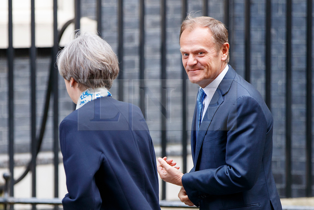 © Licensed to London News Pictures. 06/04/2017. London, UK. UK Prime Minister THERESA MAY welcomes President of the European Council DONALD TUSK to Downing Street in London on 6 April 2017. Photo credit: Tolga Akmen/LNP