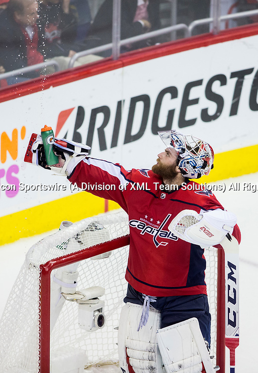 WASHINGTON, DC - MAY 21: Washington Capitals goaltender Braden Holtby (70) squeezes his water bottle during the third period during game 6 of the NHL Eastern Conference  Finals between the Washington Capitals and the Tampa Bay Lightning, on May 21, 2018, at Capital One Arena, in Washington D.C. The Caps defeated the Lightning 3-0<br /> (Photo by Tony Quinn/Icon Sportswire)