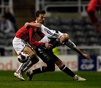 Photo: Jed Wee/Sportsbeat Images.<br /> Newcastle United v AZ Alkmaar. UEFA Cup. 08/03/2007.<br /> <br /> Alkmaar's Barry Opdam (L) wrestles with Newcastle's Antoine Sibierski for the ball.