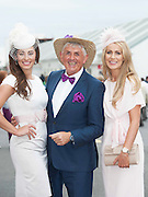 28/07/2014 Galway girls  Andrea Guerrero and Mary Lee  with Noel Cunningham at the first evening of the Galway Summer Racing Festival at Ballybrit in Galway City. Photo:Andrew Downes