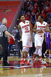 29 December 2016:  Ray Natili pushes a celebration by Phil Fayne(10) and MiKyle McIntosh(11) away from midcourt during an NCAA  MVC (Missouri Valley conference) mens basketball game between the Evansville Purple Aces the Illinois State Redbirds in  Redbird Arena, Normal IL