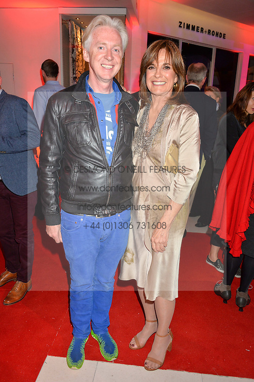 PHILIP TREACY and LINDA GRAY at a private view of Marilyn - The Legacy of a Legend held at the Design Centre, Chelsea Harbour, London on 25th May 2016.