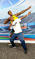 Mo Farah poses with Usain Bolt's Madame Tussauds wax figure at the British Athletics Sainsbury's Anniversary Games. <br /> London. Britain<br /> Saturday, July 27, 2013<br /> Picture by i-Images<br /> UK ONLY