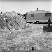 Young boy outside of caravan, Glastonbury, Somerset, 1989