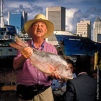 Environmental portrait of T O Sykes well known joker and owner of the historic restaurant Big Fish, on the Miami River.