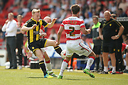 Burton Albion midfielder on loan from Birmingham City, Mark Duffy (21) tackles Doncaster Rovers defender Mitchell Lund (2)  during the Sky Bet League 1 match between Doncaster Rovers and Burton Albion at the Keepmoat Stadium, Doncaster, England on 8 May 2016. Photo by Simon Davies.