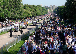 © Licensed to London News Pictures. 19/05/2018. Windsor, UK.  Royal fans gather on the Long Walk before the arrival of The Duke and Duchess of Sussex after the marriage ceremony at Windsor Castle. Photo credit: Peter Macdiarmid/LNP