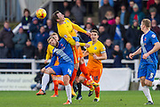 Garry Thompson (Midfielder) of Wycombe Wanderers wins the high ball beeting Hartlepool United midfielder Nicky Featherstone during the Sky Bet League 2 match between Hartlepool United and Wycombe Wanderers at Victoria Park, Hartlepool, England on 16 January 2016. Photo by George Ledger.