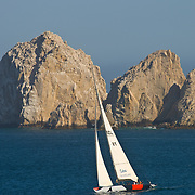 Sailboat cruising Cabo San Lucas Bay.