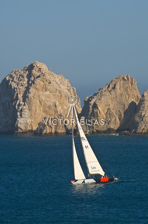 Sailboat cruising Cabo San Lucas Bay.
