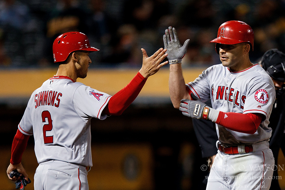 OAKLAND, CA - APRIL 04:  Danny Espinosa #3 of the Los Angeles Angels of Anaheim is congratulated by Andrelton Simmons #2 after hitting a three run home run against the Oakland Athletics during the ninth inning at the Oakland Coliseum on April 4, 2017 in Oakland, California. The Los Angeles Angels of Anaheim defeated the Oakland Athletics 7-6. (Photo by Jason O. Watson/Getty Images) *** Local Caption *** Danny Espinosa; Andrelton Simmons