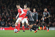 Arsenal midfielder Granit Xhaka (29) shields ball from Bayern Munich midfielder Thiago Alcantara (6) during the Champions League round of 16, game 2 match between Arsenal and Bayern Munich at the Emirates Stadium, London, England on 7 March 2017. Photo by Matthew Redman.