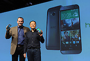 Peter Chou, right, CEO, HTC Corporation, and Jason Mackenzie, left, President, HTC America, announce that the HTC One (M8), the company's new flagship smartphone, is available online in the US today, Tuesday, March 25, 2014, during an event in New York. (Photo by Diane Bondareff/Invision for HTC/AP Images)