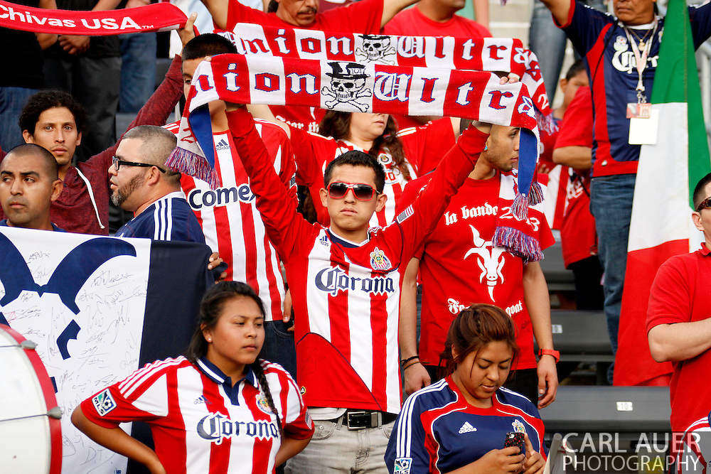 May 25th, 2013 Commerce City, CO - A Chivas USA fan holds up his team scarf during the National Anthem prior to the start of action in the MLS match between Chivas USA and the Colorado Rapids at Dick's Sporting Goods Park in Commerce City, CO