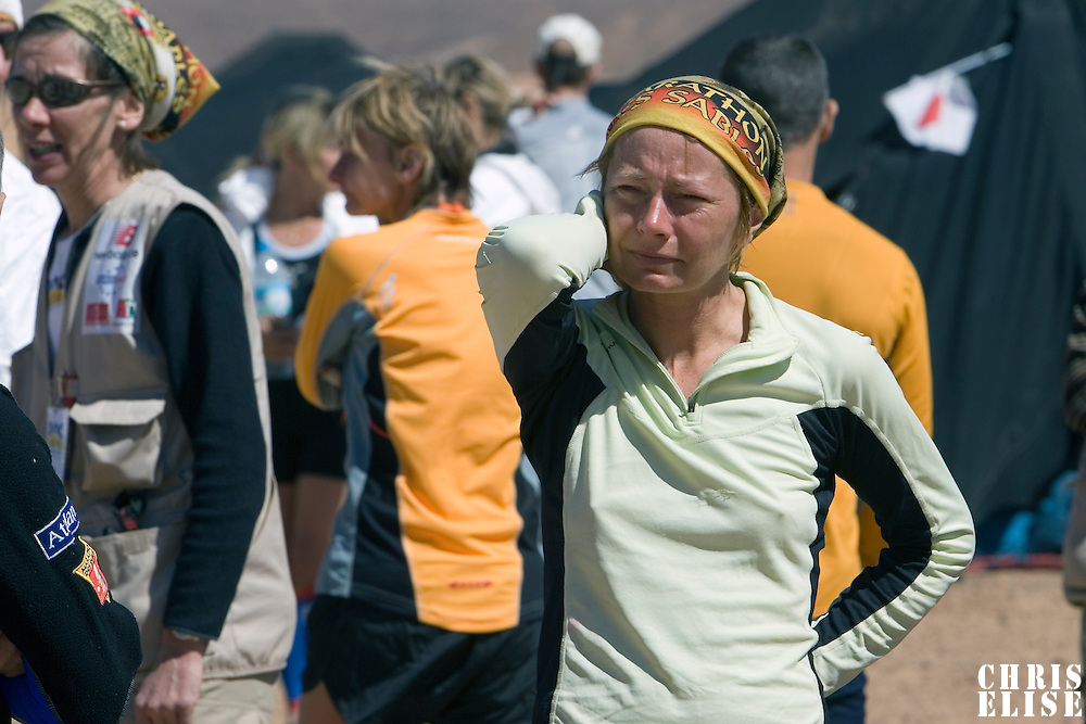 29 March 2007: A runner cries as she listens to Race Director Patrick Bauer while he informs the participants and the organisation of the death of #53 Bernard Julé of France at 06H35. Bernard Julé was found unconscious by his tent-mates at 6H30 this morning. The organisation's medical team was called immediately and confirmed his death. Bernard Julé died after fourth and longest stage of the 22nd Marathon des Sables between jebel Zireg and west of Kfiroun (43.8 miles). The Marathon des Sables is a 6 days and 151 miles endurance race with food self sufficiency across the Sahara Desert in Morocco. Each participant must carry his, or her, own backpack containing food, sleeping gear and other material.