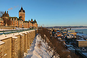 Chateau Frontenac, opened 1893, designed by Bruce Price as a chateau style hotel for the Canadian Pacific Railway company or CPR, seen from the Dufferin Terrace, in Quebec City, Quebec, Canada. The building was extended and the central tower added in 1924, by William Sutherland Maxwell. The building is now a hotel, the Fairmont Le Chateau Frontenac, and is listed as a National Historic Site of Canada. On the right is the Saint Lawrence river. The Historic District of Old Quebec is listed as a UNESCO World Heritage Site. Picture by Manuel Cohen