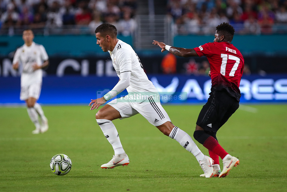 July 31, 2018 - Miami Gardens, Florida, USA - Real Madrid C.F. defender Theo Hernandez (15) drives the ball past Manchester United F.C. midfielder Fred (17) during an International Champions Cup match between Real Madrid C.F. and Manchester United F.C. at the Hard Rock Stadium in Miami Gardens, Florida. Manchester United F.C. won the game 2-1. (Credit Image: © Mario Houben via ZUMA Wire)